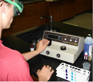 Research student uses fluorometer